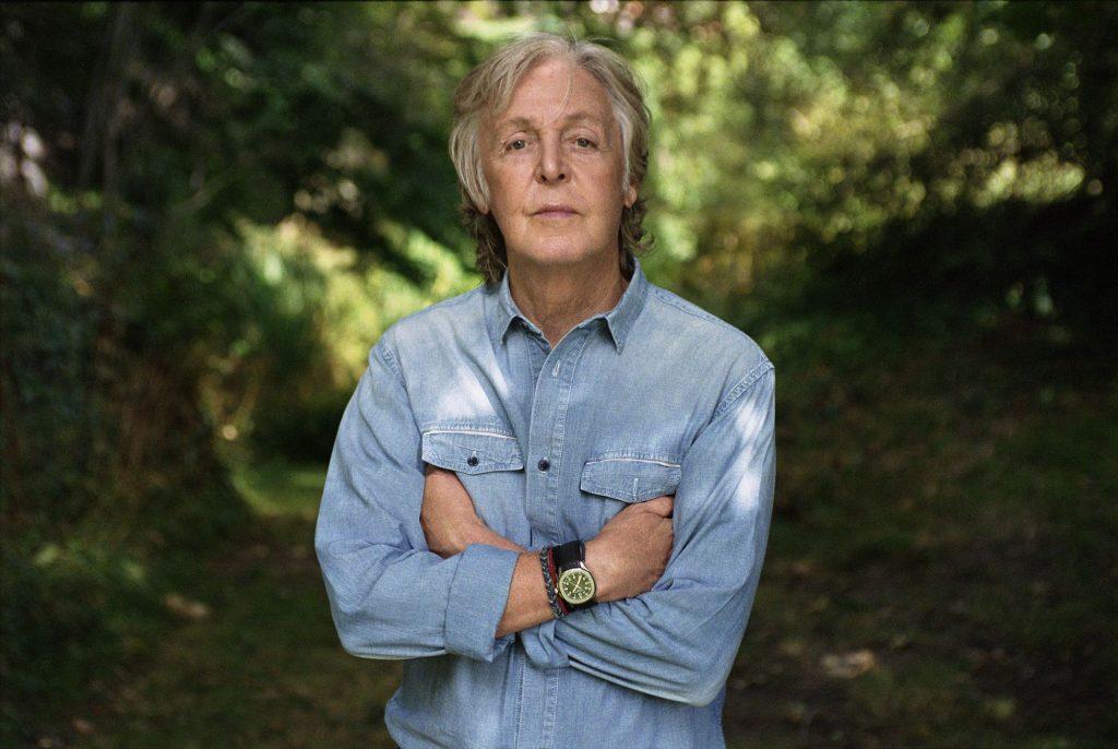 Paul McCartney arms folded